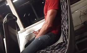 Cute dude wanking his cock on a bus