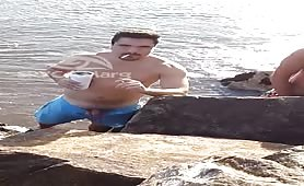Latino pissing on the beach
