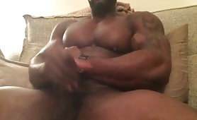 Caught Black bodybuilder jerking off and cumming on cam