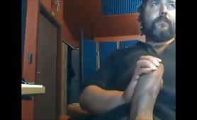 big bear masturbating in front of a webcam