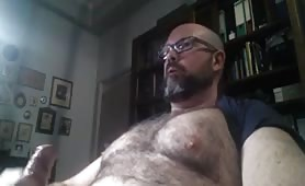 Hairy bear beating his huge cock and cumshot