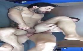 Cute stud with a huge cock fucks a bearded Latino