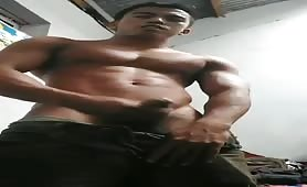 Horny Asian dude cums on cam