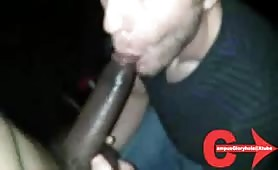 Sucking a big cock in an adult video arcade booth