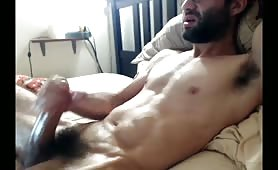 Arab stud jerking his huge fat cock