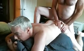 Cute gray-haired daddy carrying his  friend's cock through his ass