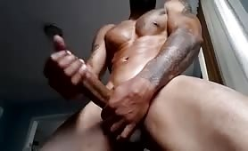 Hot muscular black stud stroking his tasty cock