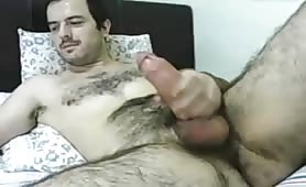 Hairy spanish guy showing his fat cock on webcam