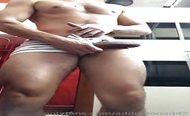 Latin guy with muscular legs jerks his huge cock