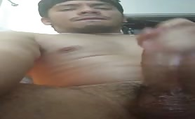 Horny young latino rubs his huge cock in front of the camera