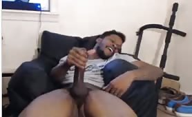 Big black monster cock guy chilling on his couch