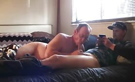 Mature married man sucks a guy's cock in his wife's bed