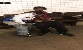 Two homeless guys having oral fun at a subway station