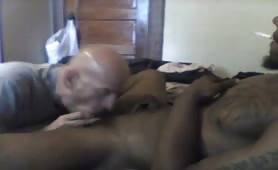 Big black cock jamaican getting a blowjob from a mature guy