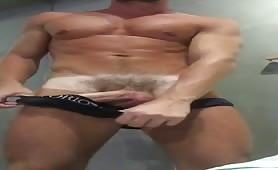 Big sexy tanned guy stroking his delicious cock