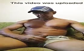 Well endowed mature man stroking his cock