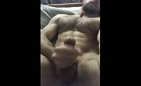 Very horny hairy stud stroking his delicious cock