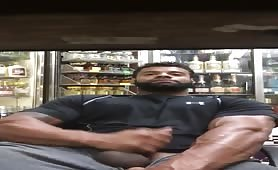 Big muscular liquor store worker stroking his huge cock