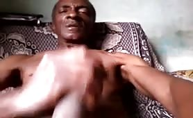 Horny old black Dominican stroking his long cock