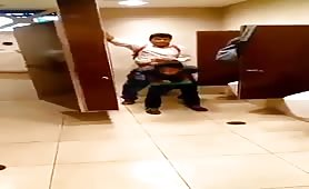 Young latinos fucking in a public bathroom