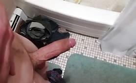 Horny dude stroking his cock in a public toilet