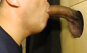 young white guy sucking a horse dick thru a glory hole