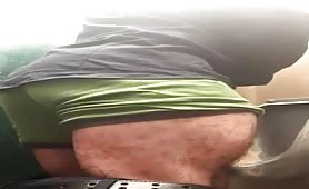Bodybuilder jerking off at a public toilet