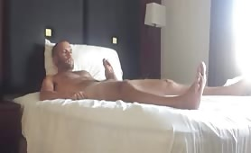 Horny white dude jerking on the bed