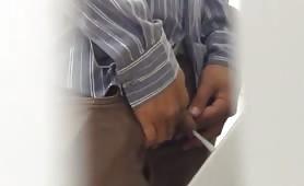 hidden cam shooting cocks in a public bathroom