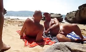Mature gay guys having fun in a nude beach