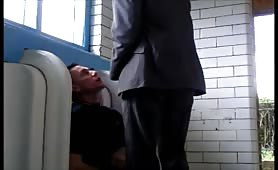 horny guy getting a facial at the public urinal