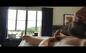 Horny beard dude jerking off and shooting a huge load