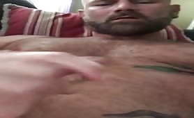 Hot bearded stud stroking his tasty cock
